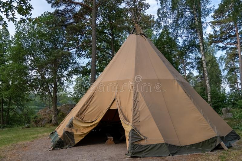 A large traditional teepee tent with luxurious glamping interior provides alternate but comfortable lodging for outdoor adventurer. A large traditional teepee royalty free stock photo