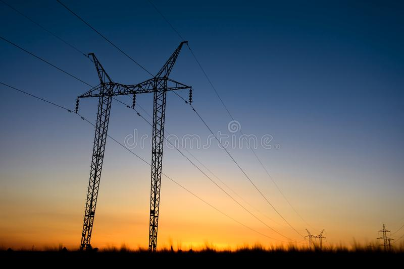 Large transmission towers at blue hour royalty free stock photo