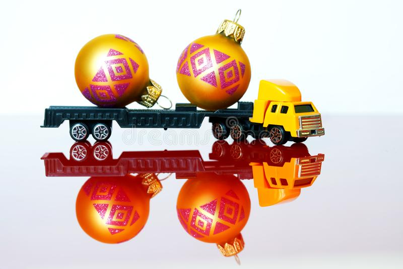A large truck carries toys for the celebration of Christmas. Delivery of non-standard oversized cargo stock photo