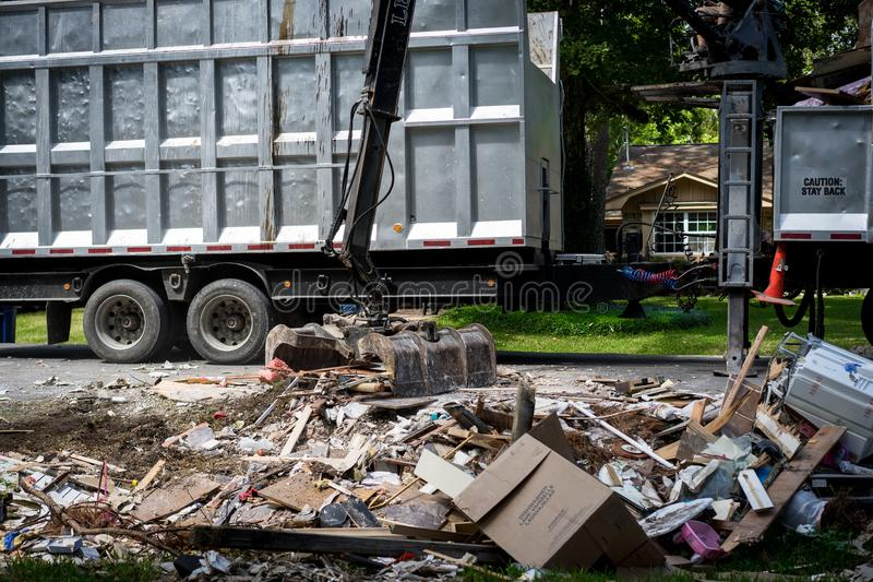 Large truck picking up trash and debris outside of Houston neighborhood stock image