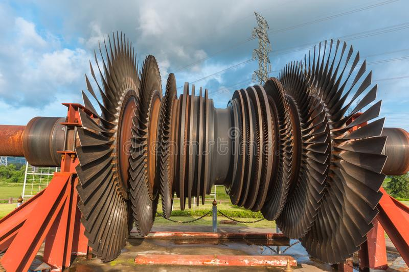 Large turbine blades used steam boiler in coal power plant. Old large turbine blades used steam boiler in coal power plant at maemoh power plant lampang royalty free stock photography