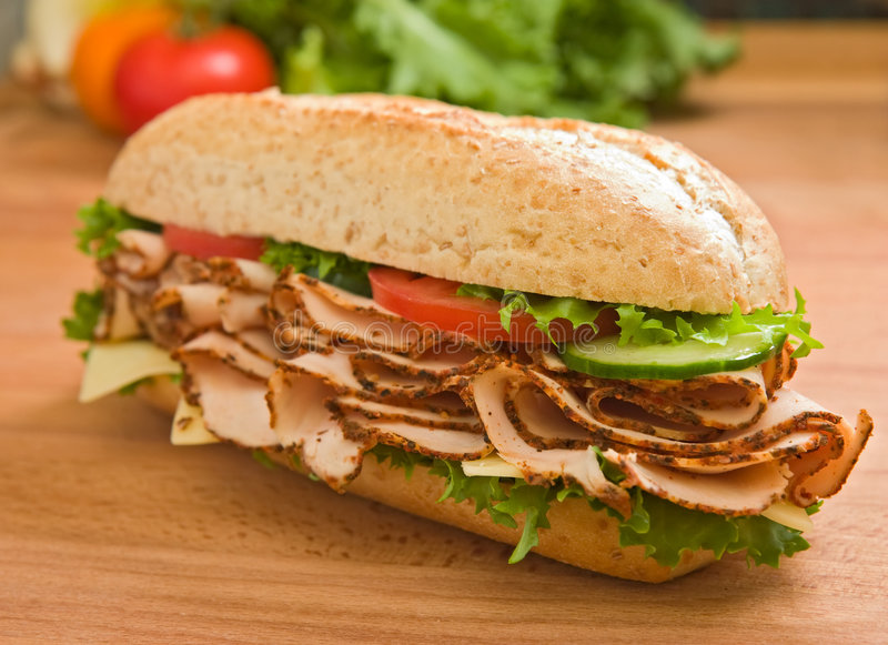 Download Large Turkey Breast Sandwich On A Wooden Surface Stock Image - Image: 5358933
