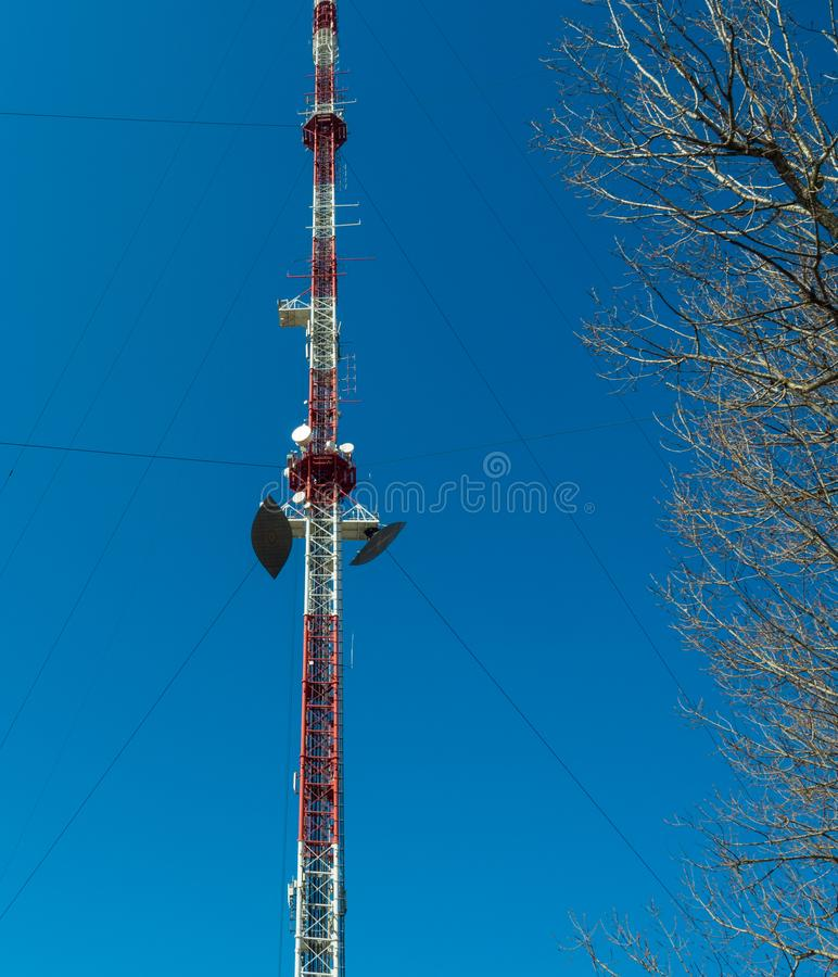 Large TV and radio tower with several parabolic antennas and cellular communication equipment. Tula, Russia royalty free stock images