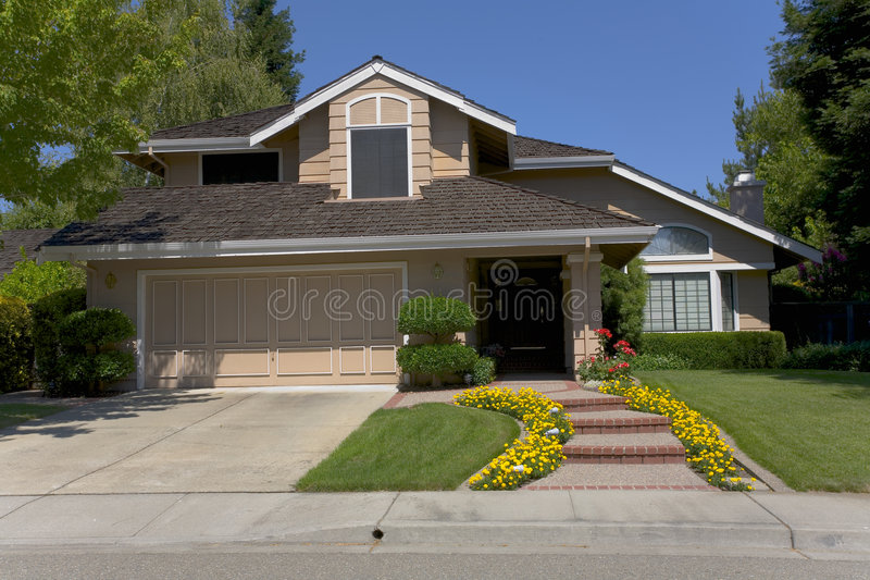 Download Large Two-Story Home With Pretty Landscaping Stock Photo - Image: 1099218