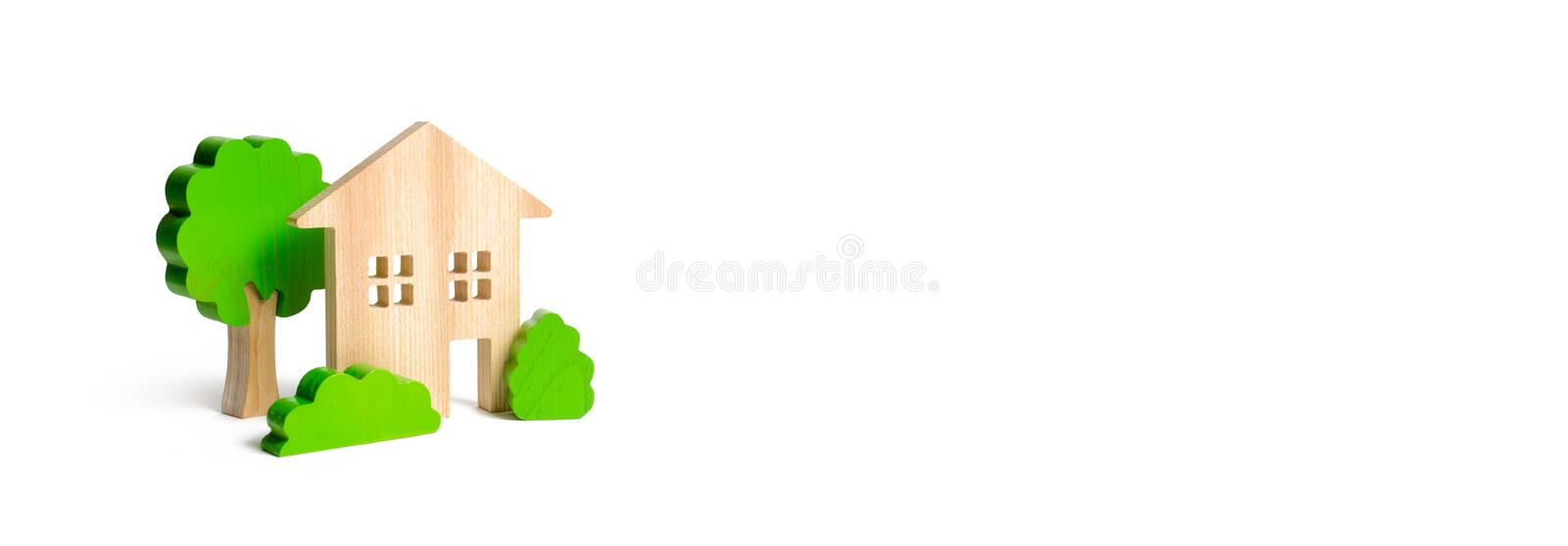 Large two-story house surrounded by bushes and trees on an isolated background. Accommodation for families. Urbanism and urban royalty free stock image