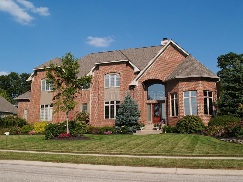 Large Two Story New Brick Home With Turret royalty free stock photos