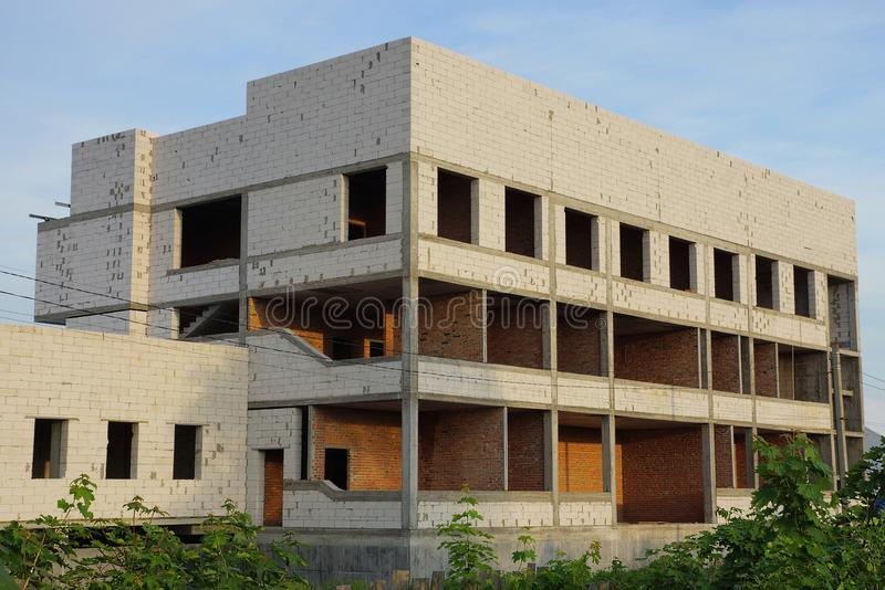 Large unfinished white brick house on a building site royalty free stock photos