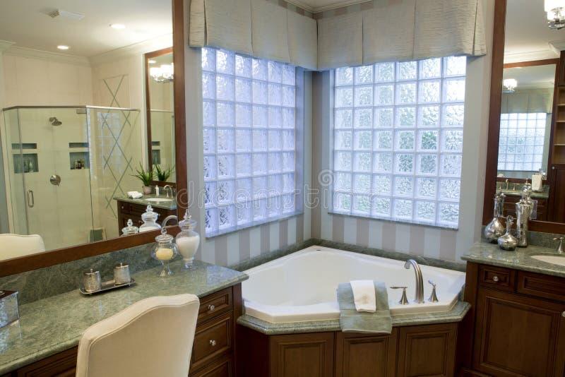 Large Upscale Master Bathroom Stock Photo