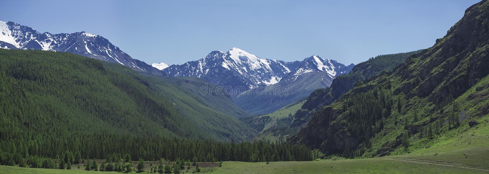 large valley in the mountains stock photos