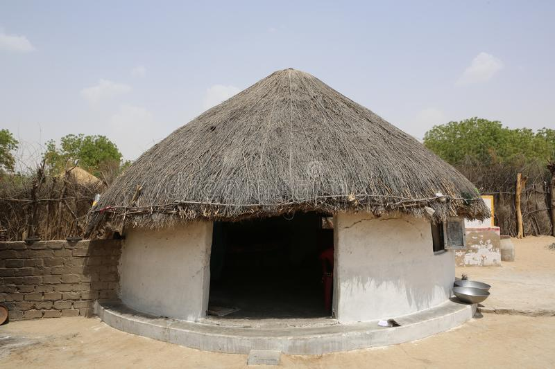 A large version of Thari conical roof hut stock photography