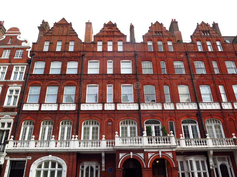 Victorian Building facades in downtown London. Large view of apartment buildings in central London, Great Britain. Beautiful facades in weathered brick with royalty free stock photos
