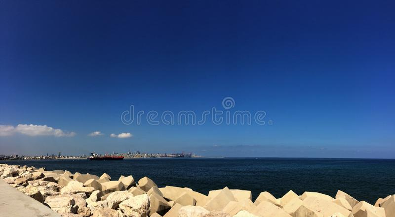 Large view of the blue sea and Beirut harbor and Beirut city skyline  in background, Lebanon royalty free stock photography