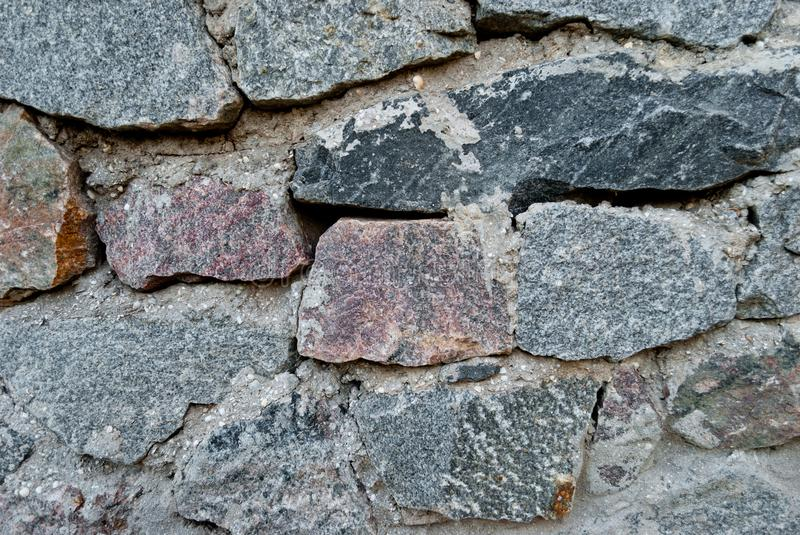 Wall of stones, stone wall texture of gray color on a summer day royalty free stock photo