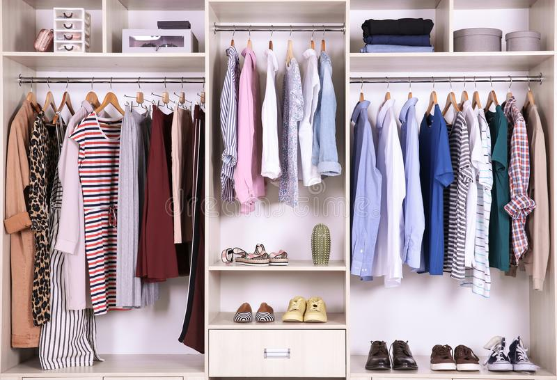 Large wardrobe with different clothes stock image