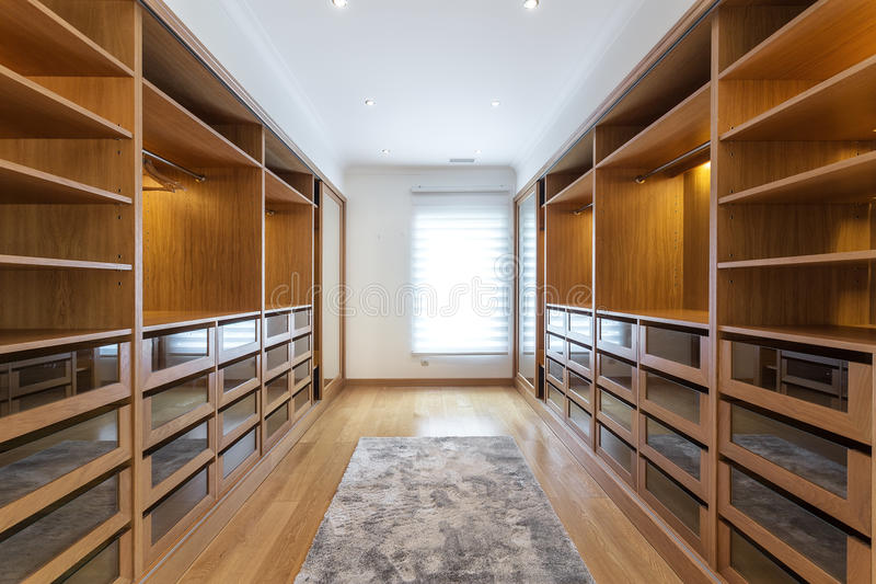 Large wardrobe room, with empty shelves. royalty free stock photo
