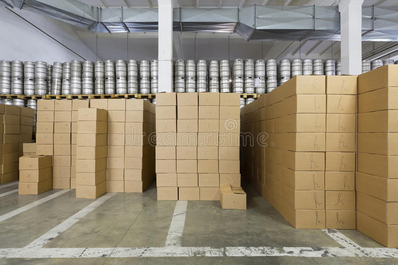 Large warehouse with beer kegs and cardboard boxes in stock brewery Ochakovo stock image