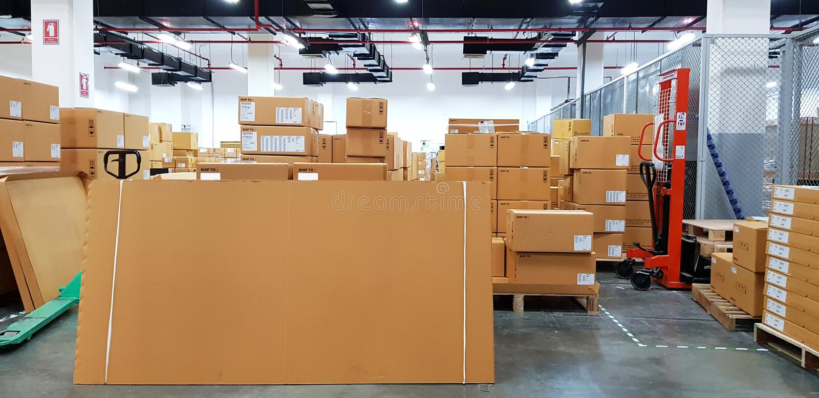 Large warehouse logistic or distribution center. Interior of warehouse with rows of shelves with big boxes.  stock photography