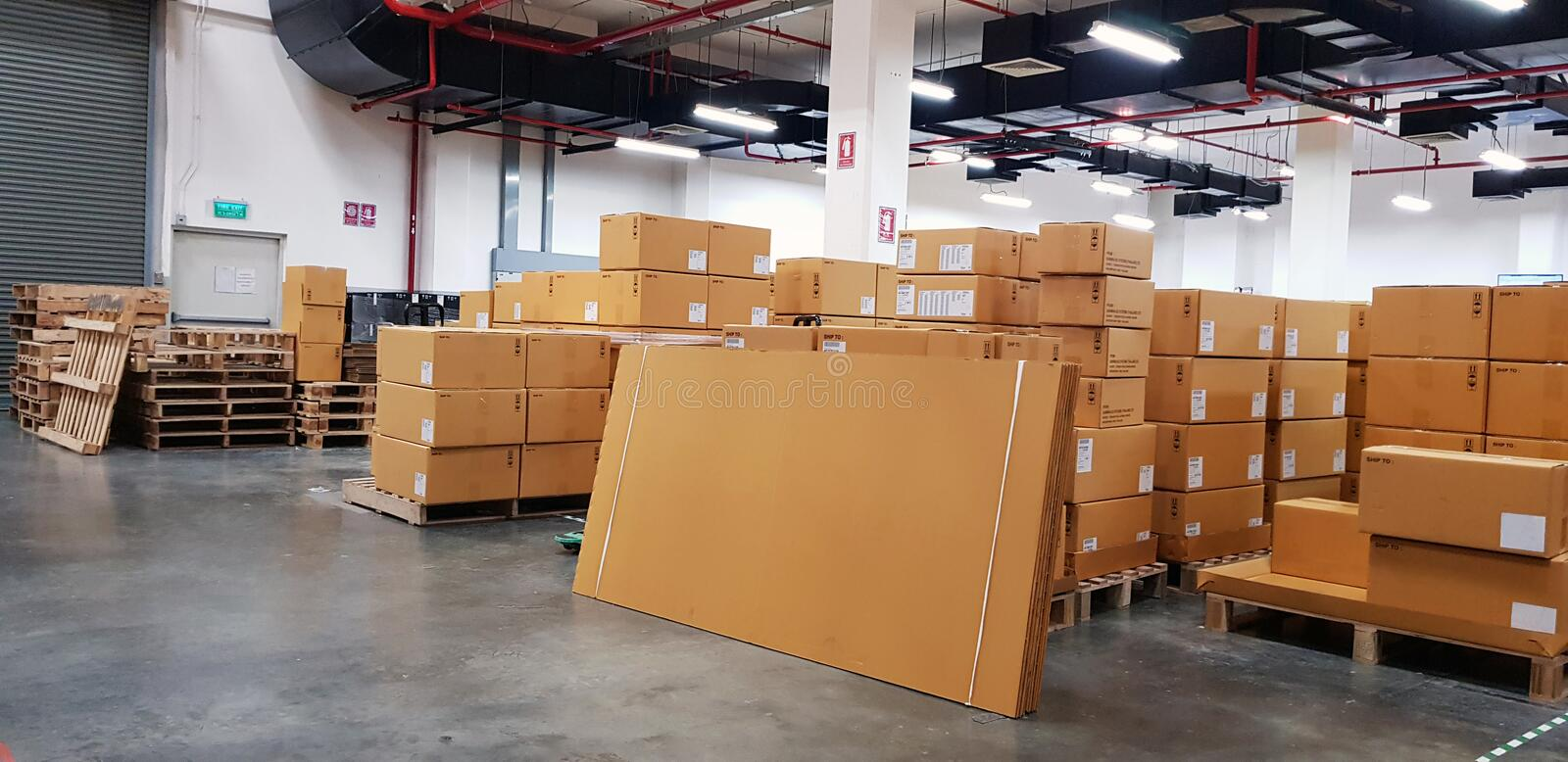 Large warehouse logistic or distribution center. Interior of warehouse with rows of shelves with big boxes.  royalty free stock image
