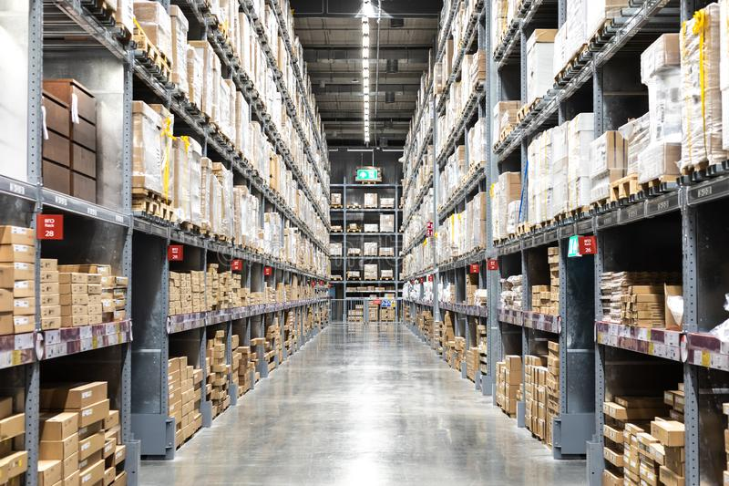 Large warehouse logistic or distribution center. Interior of war. Ehouse with rows of shelves with big boxes royalty free stock images