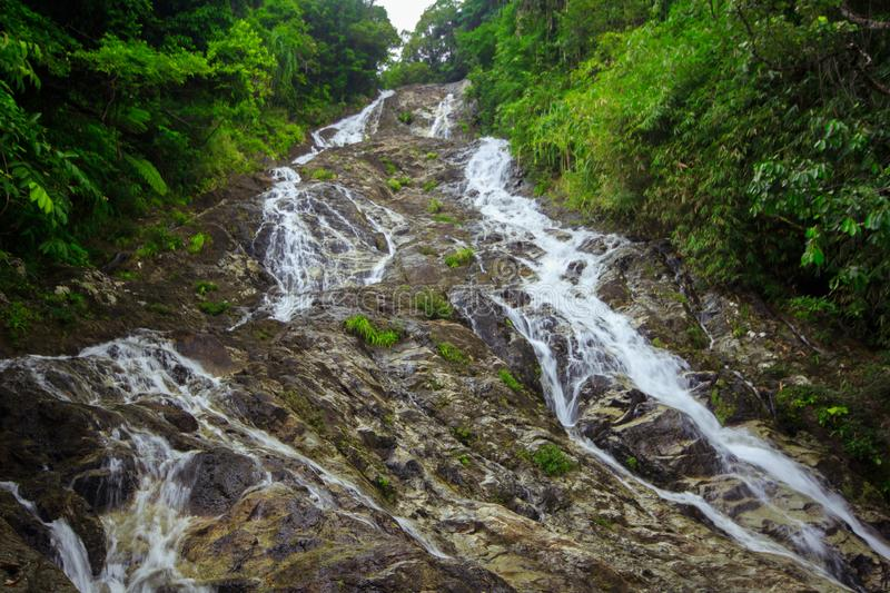 A large waterfall flowing in the forest royalty free stock photos