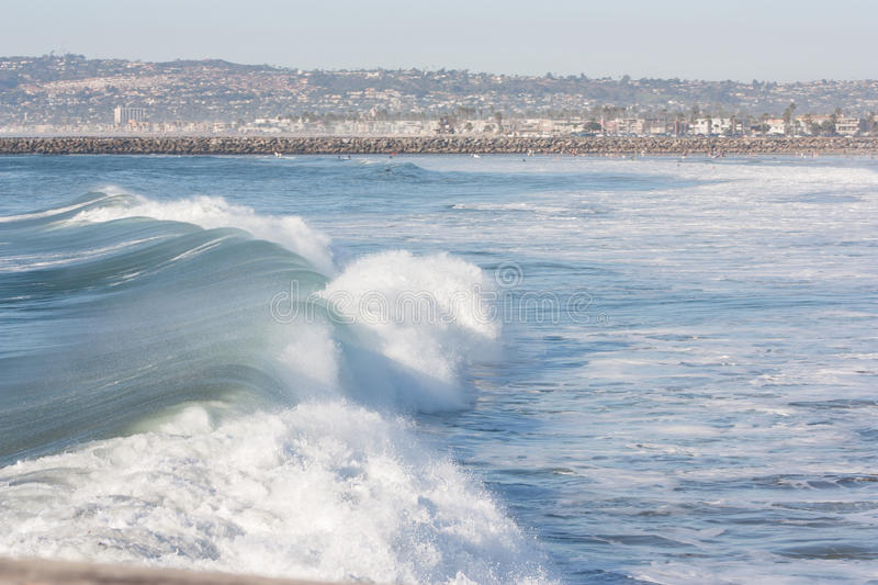 Large wave with San Diego in the background royalty free stock photos