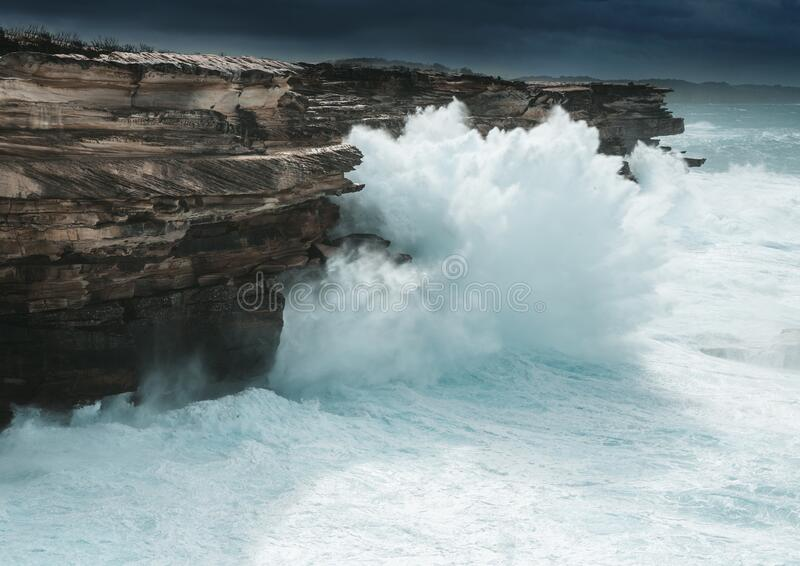 Large waves smash the cliff coast of Sydney stock images