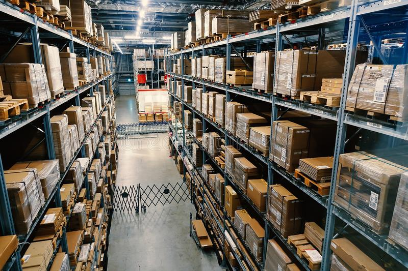 Large wharehouse with rows of shelves and goods boxes. Industry concept. used for background or graphic source. Image royalty free stock photography