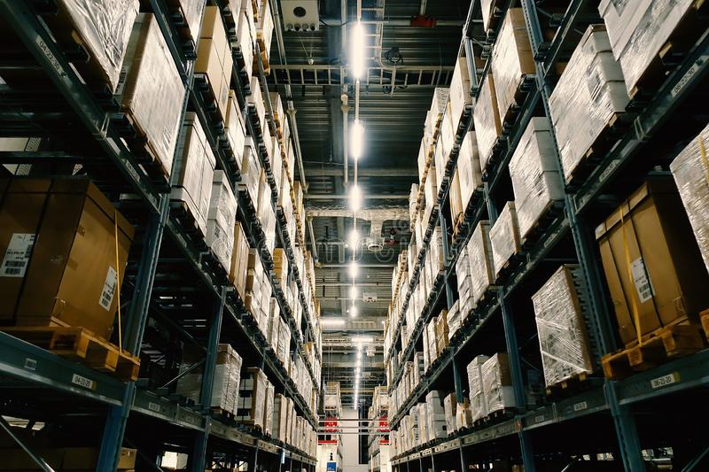 Large wharehouse with rows of shelves and goods boxes. Industry concept. used for background or graphic source. Image stock photo