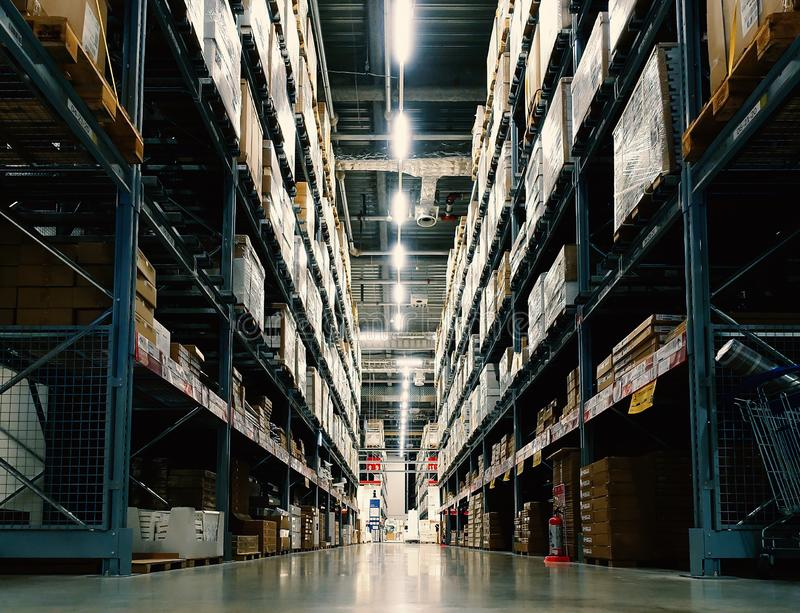 Large wharehouse with rows of shelves and goods boxes. Industry concept. used for background or graphic source. Image stock images