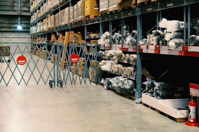 Large wharehouse with rows of shelves and goods boxes. Industry concept. used for background or graphic source. Image royalty free stock images