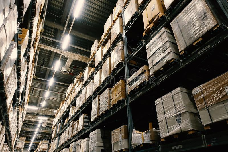Large wharehouse with rows of shelves and goods boxes. Industry concept. used for background or graphic source. Image royalty free stock photos