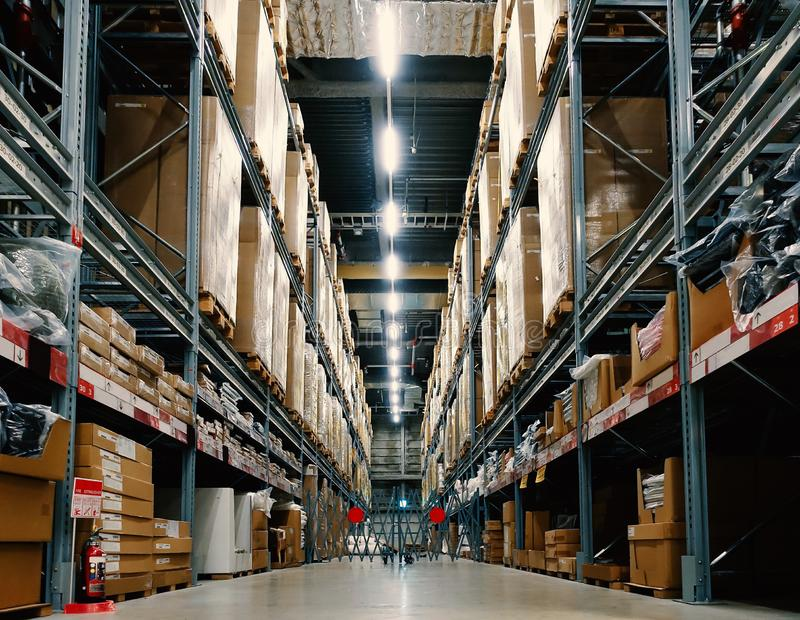Large wharehouse with rows of shelves and goods boxes. Industry concept. used for background or graphic source. Image stock photos