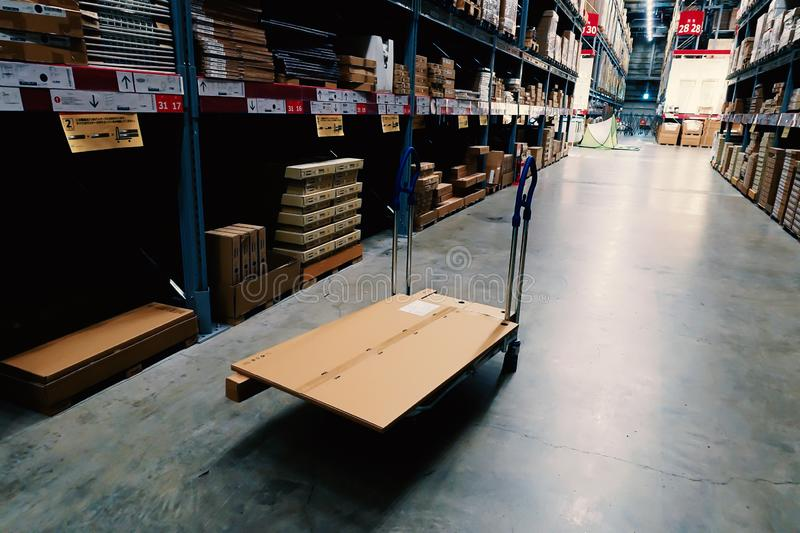 Large wharehouse with rows of shelves and goods boxes. Industry concept. used for background or graphic source. Image royalty free stock image