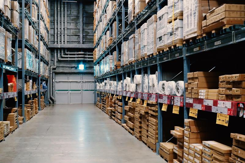 Large wharehouse with rows of shelves and goods boxes. Industry concept. used for background or graphic source. Image stock photography