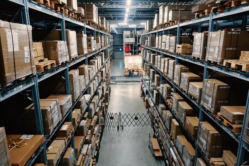 Large wharehouse with rows of shelves and goods boxes. Industry concept. used for background or graphic source. Image stock image