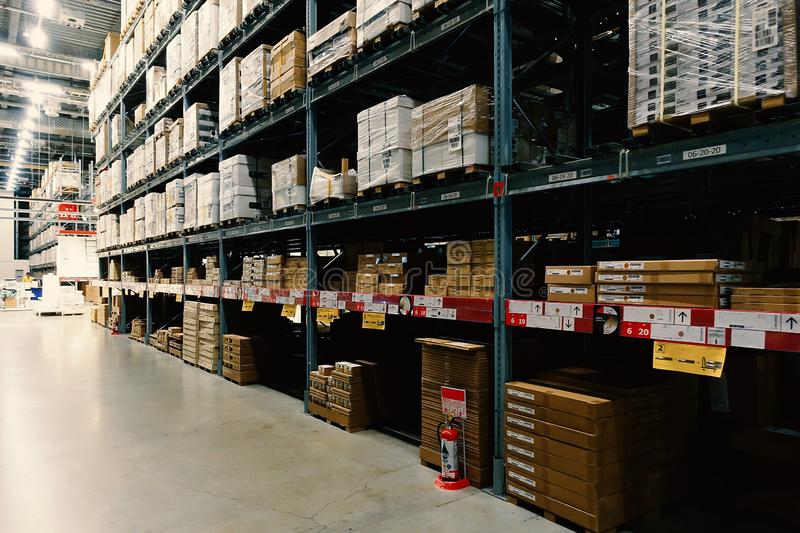 Large wharehouse with rows of shelves and goods boxes royalty free stock images
