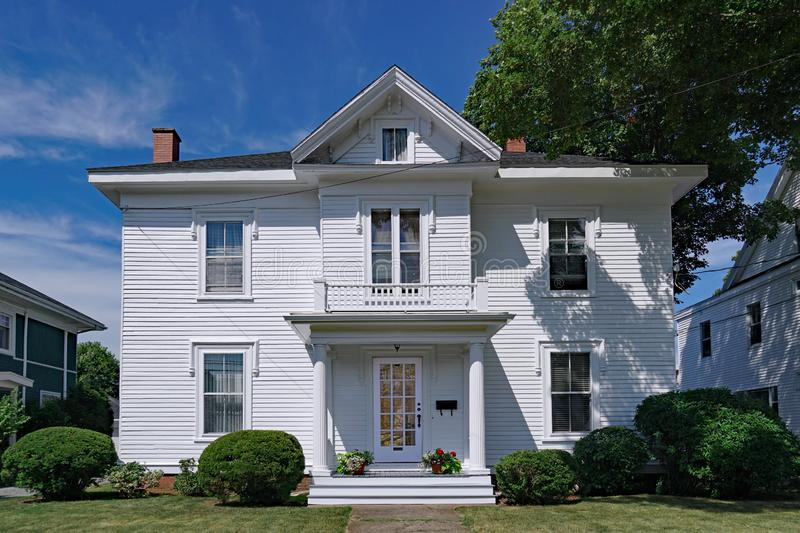 Large white clapboard house. With portico entrance and gable royalty free stock photo
