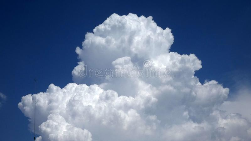 Large white cloud against blue sky stock photo