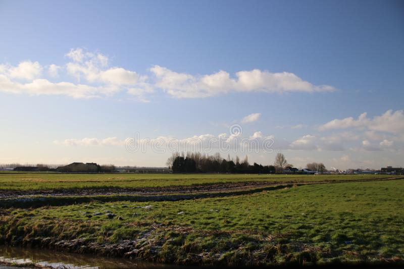 Large white clouds in blue sky over the meadows of the Zuidplaspolder in Moordrecht, stock photography