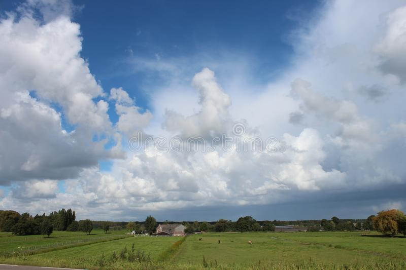 Large white clouds in blue sky over the meadows of the Zuidplaspolder in Moordrecht, royalty free stock photos