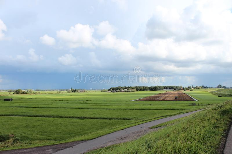 Large white clouds in blue sky over the meadows of the Zuidplaspolder in Moordrecht, stock image