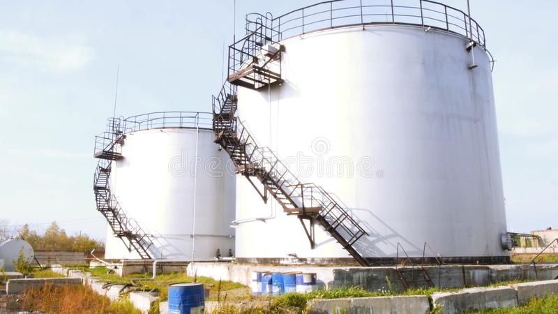 Large white Industrial tanks for petrol and oil. Stock. Fuel tanks at the tank farm. Big Industrial oil tanks in a stock photo