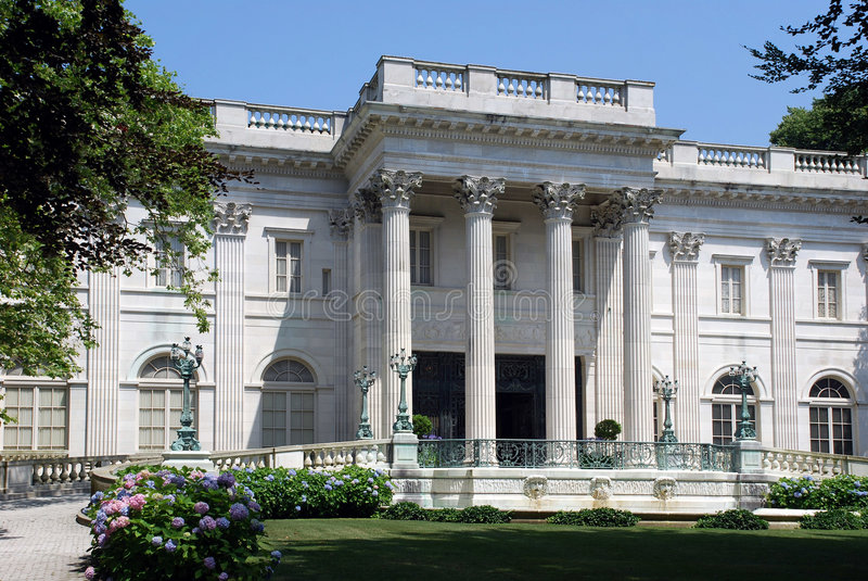 Large white mansion with columns stock photography