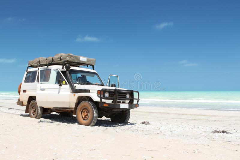 Large white offroad vehicle on the beach. In western australia stock photos