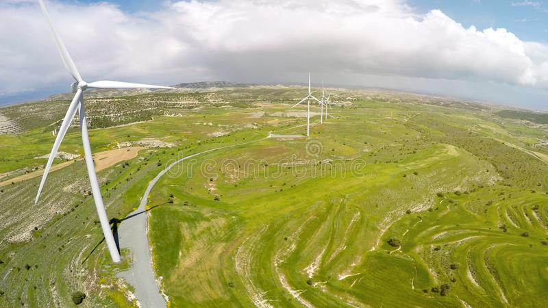 Large wind farm producing electricity for cities, alternative energy sources royalty free stock photo
