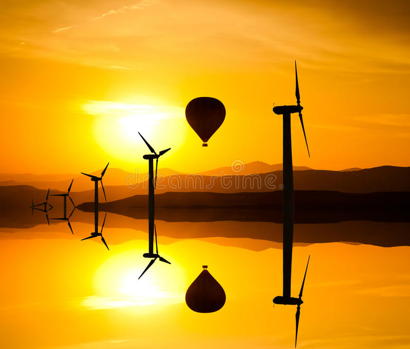 Large wind turbines in the desert against mountains royalty free stock images