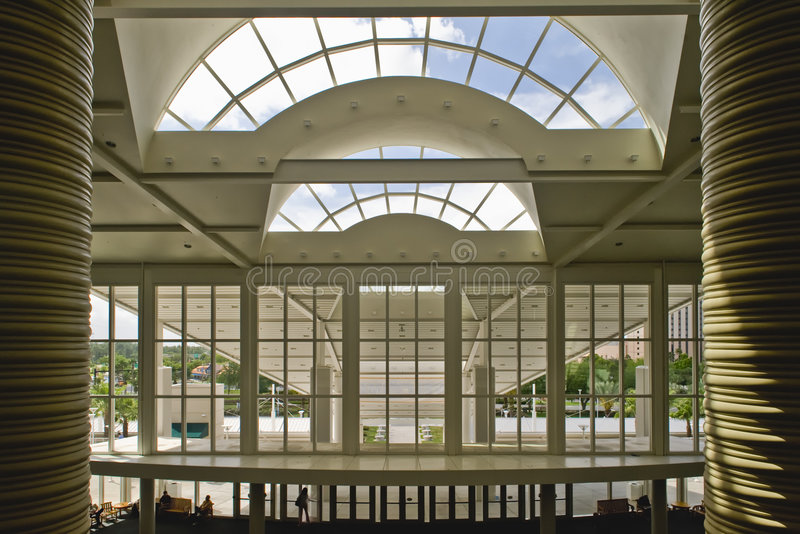 Large Windows in Building. Large windows in the front of a modern building. This is the Orange County Convention Center in Orlando, Florida stock images