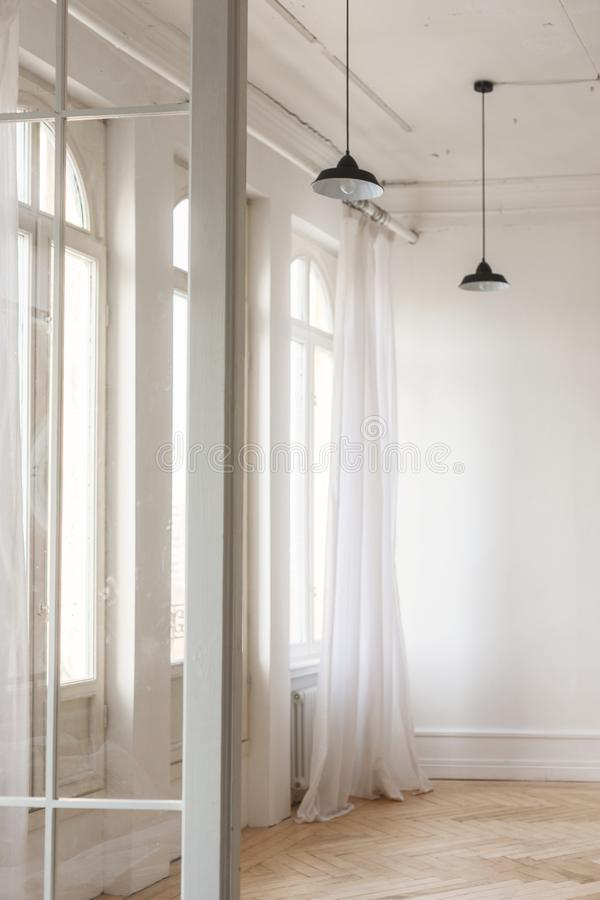 Large Windows with curtains in white loft interior royalty free stock photos
