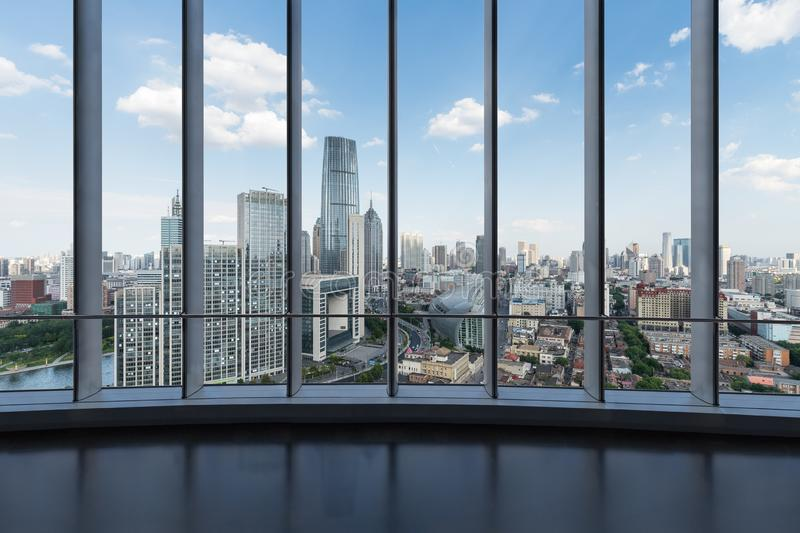 Large windows with modern cityscape stock images