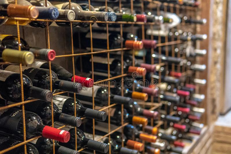 Large wine collection in cellar. Very Old Bottles of Wine Aging in Underground Wine Cellar in basement, argentina, cork, latin, america, lujan, cuyo, mendoza stock photos